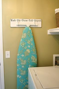 DIY ::A simple, fashionable way to hang your Ironing Board (Laundry Board Hanger Tutorial)