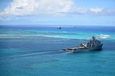 The amphibious dock landing ship USS Ashland (LSD 48) departs Saipan. The island was battered by Typhoon Soudelor Aug. 2 and Ashland arrived Aug. 7 for recovery efforts.