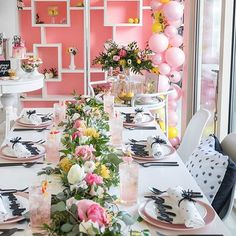 Here's a close-up of the tablescape from my mod Galentine's Day Party hosted at @brittanygidley's downtown Cleveland penthouse! I wanted to steer clear of the cliché reds and pinks for the party decor and instead incorporated bright lemon yellow and bubble gum pink, contrasted with a bold black and white abstract dot pattern. White bookcases from @eventsourcerentals (lined with pink photography paper) provided the perfect backdrop to the dining table that was draped in a lush greenery…