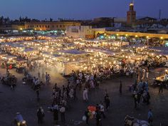 Jemaa el Fna  Marrakech, Morocco... So many food vendors, henna artists, and stuff for sale.