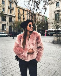 Soft and cozy faux fur jacket in coral.