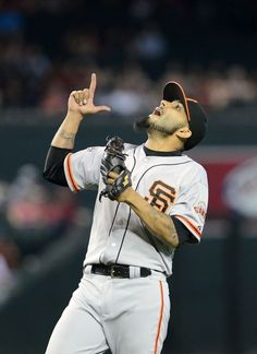 PHOENIX, AZ - JUNE 09: Closing pitcher Sergio Romo #54 of the San Francisco Giants celebrates after defeating the Arizona Diamondbacks in the ninth inning at Chase Field on June 9, 2013 in Phoenix, Arizona. The Giants defeated the Diamondbacks 6-2. (Photo by Jennifer Stewart/Getty Images)