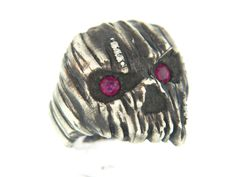 Wooden textured skull ring with diamonds and ruby eyes from Atelier Minyon