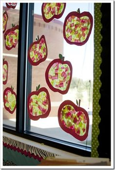 Apple stained glass with clear contact paper and tissue paper.