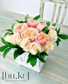 Beautiful centerpiece with vuvuzela rose and anastasia roses.