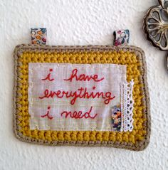 Crochet square with embroidered words