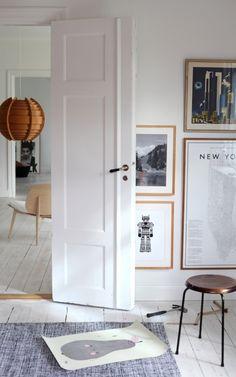 white door and wooden frames (via emmas designblogg)