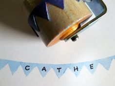 Homemade rubber roller stamp by Cathe Holden. made using a rubber band cut and glued round a seam roller... tutorial