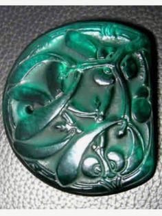 Lalique 1920 'Gui' Pendant: emerald-green glass, flat dome-shaped mistletoe decorated / rlalique.com