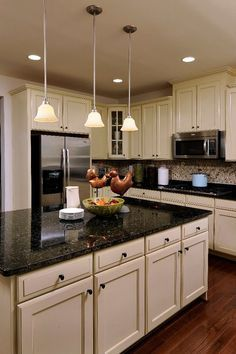 Would love to have a kitchen with an island and black marble counter tops! :)