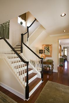 Black rail + balustrade with white spindles.