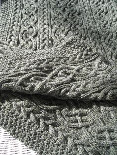 Blanket using cables from Alice Starmore's St. Brigid cardigan…