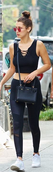 Bella Hadid: Purse – Saint Laurent Shirt – Topshop Shoes – Nike Pants – Alo Yoga sunglasses – Mykita