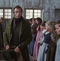 Les Mis (2012) | Hugh Jackman (Valjean) and to the right in pink Anne Hathaway (Fantine) in a scene from the film adaptation of the musical Les Misérables.