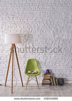 modern white brick wall in front of books and chairs