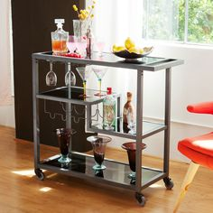 Love the multiple shelving options in this bar cart