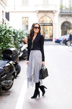 Kat Tanita of With Love From Kat wears a Rebecca Taylor skirt, Theory blouse, Stuart Weitzman highland boots and Fendi petit du jours bag in Milan.