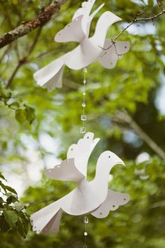 Paper doves hanging from trees.
