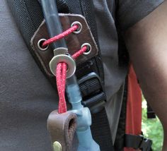 Not just a handsome emblem of quality, this small belt clip can be attached to a pack without undoing the straps, and gives secure and easy access to hydration