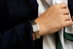 Stainless steel case with yellow gold bezel x Ivory colored dial with black Roman numerals. Stainless steel and yellow gold Panthere bracelet. Pre-owned with custom box.