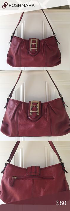 Etienne Aigner Purse Etienne Aigner Brick Red Purse. It's deceiving, it appeared small but has a lot of room and pockets. Questions?  Ask and I'll take more pics for you. Spotless inside and out. Leather and silver keychain included!! Etienne Aigner Bags Shoulder Bags