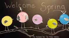 Tin can lid birds on a chalkboard to welcome spring!  #upcycle