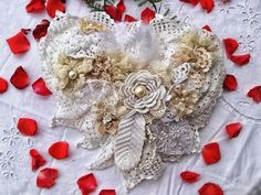 A wedding ring bearer pillow in shabby chic style made of handmade doilies and laces. If you are a shabby lover and a romantic soul then this is it.