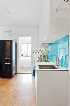 Turquoise backsplash and Smeg fridge