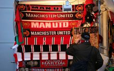 Manchester United scarves on display at a sport kiosk.