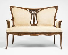 Georges de Feure SETTEE, walnut and fabric upholstery, circa 1900