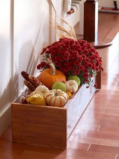 fill wooden crate or container with fall squash, mums, flowers, and more