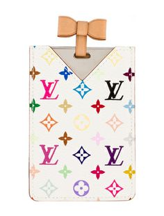 This Louis Vuitton Multicolore Mirror is perfect for chic touch-ups.