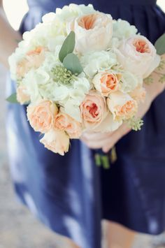 Peach Bouquet with Navy Bridesmaids -- Pretty. See the wedding on Style Me Pretty: http://www.StyleMePretty.com/southeast-weddings/2014/02/17/cloverleaf-farm-wedding/ Alea Moore Photography