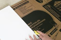 If your image of Christmas includes stockings hanging on a fireplace but your home doesn't have one, you can make a surprisingly realistic version from cardboard. Start with four cardboard display boards -- the kind students use for science projects. You can find them  at hobby or office supply stores and home centers.