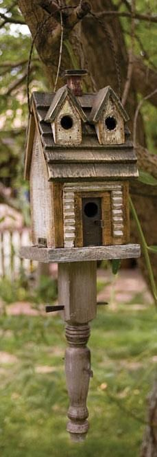 Though not made of barn-wood, this cute birdhouse sits on its on decorative…