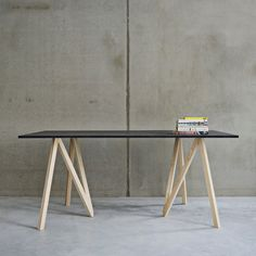 Accordion is the most compact trestle in the world – it spreads out laterally rather than folding, creating a stand for a table top. In a simple accordion-like movement, its legs fold back into a slender stick. DESIGN BY JULIEN DE SMEDT