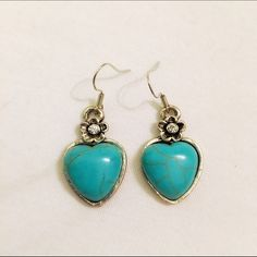 """Fashion Heart Shape Turquoise Alloy Drop Earrings Women's Fashion Heart Shape Turquoise Alloy Drop Earrings  Brand New without Tags. For Pierced ears. Great gift for someone special or nice treat for yourself.  Natural turquoise is beautiful and safe to wear. High Quality Safe Zinc Alloy Stylish & Great for Everyday Wear Hook back Style; Measures 1.25"""" in length Display mannequin is relatively small in size Comes with storage pouch Unbranded Jewelry Earrings"""