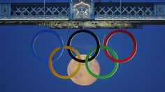 The full moon rises over Olympic London 2012 & aligns with the rings on Tower bridge. Amazing photo!