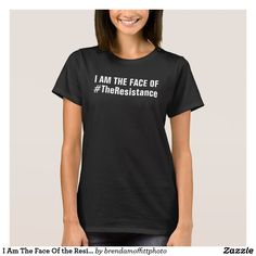 I Am The Face Of #TheResistance on the front,  Neverthless She Persisted on the back. Black T-Shirt 50 percent of the designer's net proceeds benefit the ACLU.