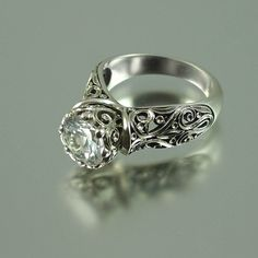 """""""Enchanted Princess"""" ring, 8mm 2.3Ct white sapphire set in carved 14K white gold, by designer Sergey Zhiboedov."""