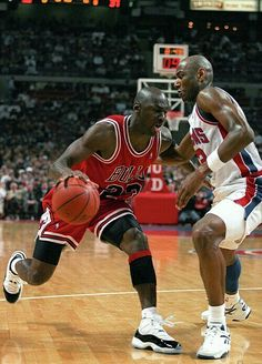 The GOAT makes moves off of the dribble against the Pistons' Michael Curry in Detroit.