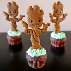 The most cutest Baby Groot cupcakes ever! They are really easy to Make! You only need 1.) cookie dough! 2.) make a baby Groot shape out of a paper! 3.) lay the paper shaped baby Groot on the dough! And cut it like a cute baby Groot! 4.) make some designes on your baby Groot and place chocolate eyes and a smile! 5.) place the baby Groot cookie on the cupcake with some frosting!! Easy!