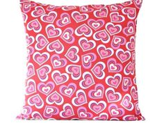 Fun pillow cover for Valentines Day! The red cotton background has hearts in shades of red, pink and purple. The back is a solid red poly…