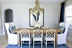 Love the combo of the farmhouse table with the Chinese chippendale chairs!
