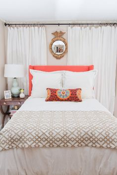 Hollie Hill Home Tour // bedroom styling // side table // accent pillows // white linens // neutrals // pop of color // headboard // coral // mint lamp // photography by Cyn Kain Photography