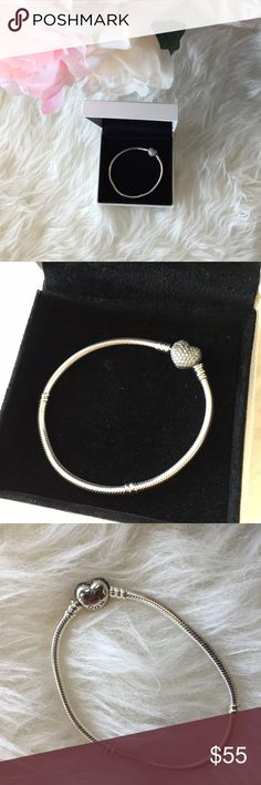 Simple Pandora ❤️ Bracelet Beautiful silver bracelet! It's so simple and Romantic! The clasp is hidden in the heart. User/good condition. Comes with white Pandora box! Pandora Jewelry Bracelets