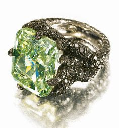 "De Grisogono extremely rare, 25-carat green diamond for $ 7.3 million. The cushion-cut stone is set in a gold ring that features an additional seven carats of black diamonds. It is described by Fawaz Gruosi, the founder of de Grisogono, as ""the finest modern specimen of a green diamond."""