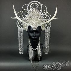 www.etsy.com/shop/MissGDesignsShop New crystal headdress. This is by far the most sparkly piece I have ever made. The entire base is covered in crystals and she is ridiculous in the light. Made with faux antlers.