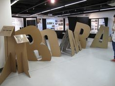 Y sinking cardboard letters 'BOMBA' by HD in Visual Communication Students Exhibition Stand Design, Exhibition Booth, Display Design, Booth Design, Expo Stand, Event Signage, Church Stage Design, Cardboard Furniture, Signage Design