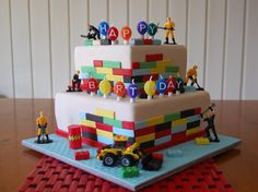 Seth - Choc mud and choc mint mud cake. Covered in fondant. Lego blocks made from fondant/gumpaste mix. Lego Toy loader sitting at base. Construction men are also toys. I made this cake as a donation for a little 5 year old boy whos mummy is battling Breast Cancer. She loved it and I hope it puts a smile on her sons face. I wanted to help out to make her day a little bit less stressful.